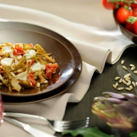 Cooked artichoke, fresh tomato and Tomino salad